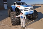 "Hall Brothers Racing driver Mike Miller will take the wheel of the Ram Monster truck named ""Mopar Muscle"" which makes it's debut at Monster Jam in Detroit on Jan 11, 2014. The Mopar Muscle Monster Truck is a based on a 2014 RAM Heavy Duty truck, and is powered by a 565 cubic inch supercharged version of the famous 426 Gen II Race HEMI engine which celebrates the 50th anniversary of its introduction in 2014."