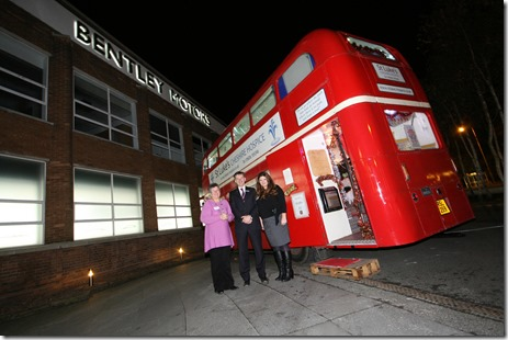St Luke's deputy matron Gloria Mundie and director Andrea Fragata Ladiara with Bentley Motors' Mike Hawes outside the Santa's Grotto aboard Luke the Bus