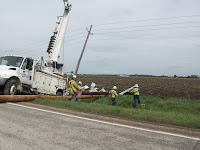 Alliant Energy Crews work to repair downed power lines in Henry County