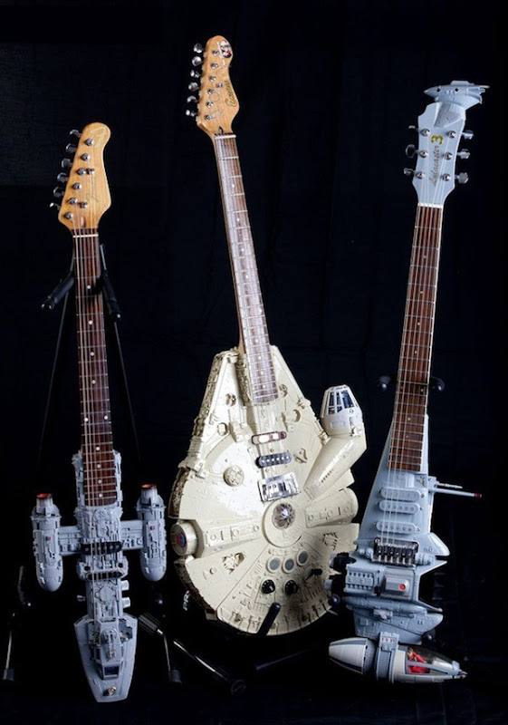 CORBY, UNITED KINGDOM - MARCH, 27, 2012: <br /><br />Tom Binghams Anakin Jedi Starfighter guitar, Millennium Falcon guitar and his B-wing fighter guitar<br />Music-mad Tom Bingham is rocking out of this world with his incredible collection of - STAR WARS-themed guitars.<br />Creative Tom, 64, has built themed instruments for 10 years including an electric guitar in the style of a Millennium Falcon and the Jedi Anakin Fighter. Pictures: Adam Gerrard