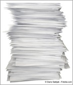 Piles up papers