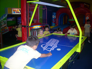 Enjoying a fun game of air hockey!