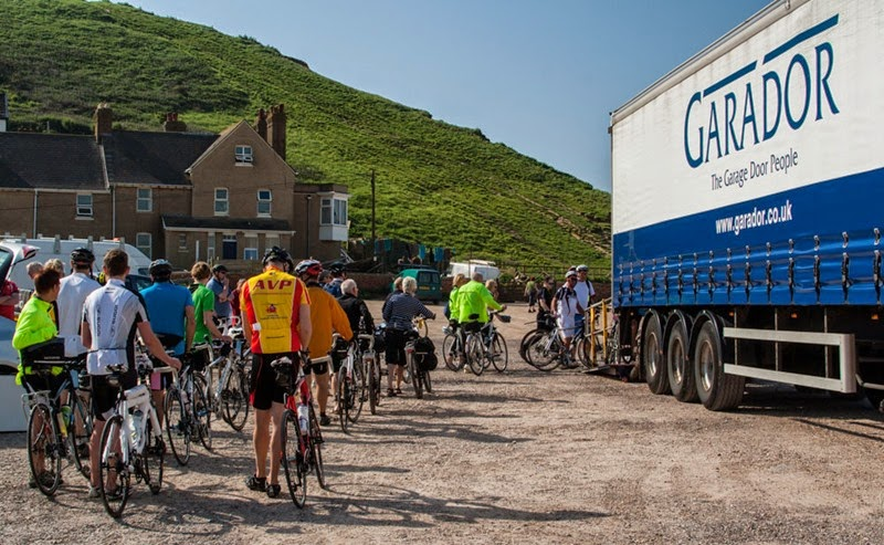 Cyclists loading bikes onto Garador lorry, for Coast to Coast Charity Cycle Ride