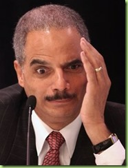 eric_holder_hand_to_head