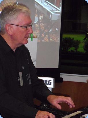 Gordon Sutherland playing on John Perkin's Korg Pa3X. Photo courtesy of Delyse Whorwood.