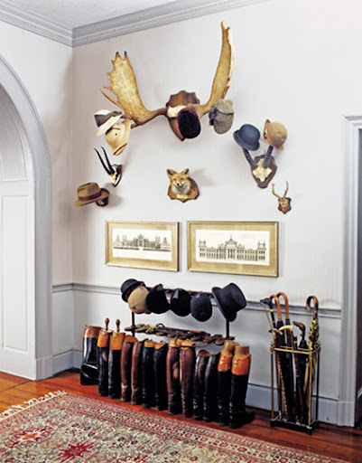 Antlers make a whimsical hat rack, and the boot display is sophisticated yet practical. (apartmenttherapy.com)