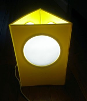 Plastic triangle lamp yellow on
