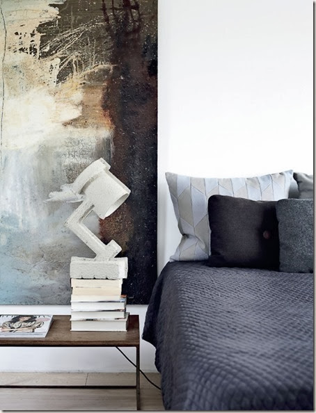 bedroom.-concrete-lamp-and-abstract-painting-in-gorgeous-tones.