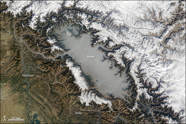 The Moderate Resolution Imaging Spectroradiometer (MODIS) on NASA's Terra satellite captured this image of haze in the Kashmir Valley on 5 December 2014. Much of the haze visible in the image likely had its origins in charcoal production or the burning of biomass. Charcoal is widely used to heat homes in the Kashmir Valley in the winter and emits several types of polluting gases and aerosol particles into the atmosphere. Photo: Jeff Schmaltz / LANCE/EOSDIS Rapid Response