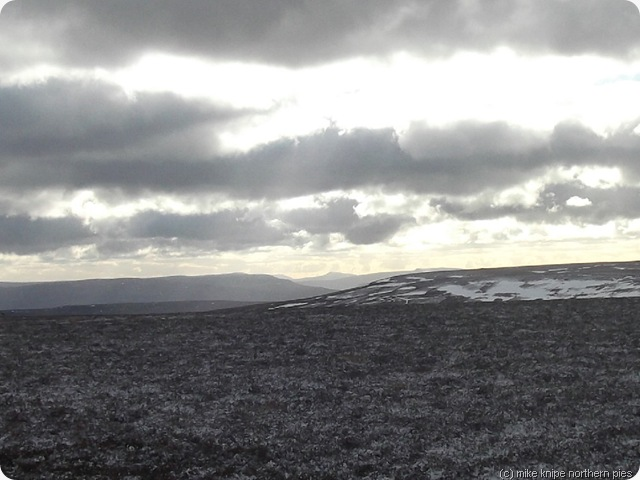 whernside peeps through a gap in the hills