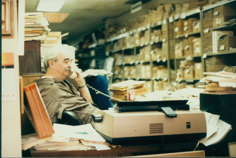 Jim Kepner on the phone at the National Gay Archives. 1986.