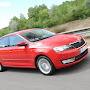 2013-Skoda-Rapid-Sedan-Red-Color-6.jpg