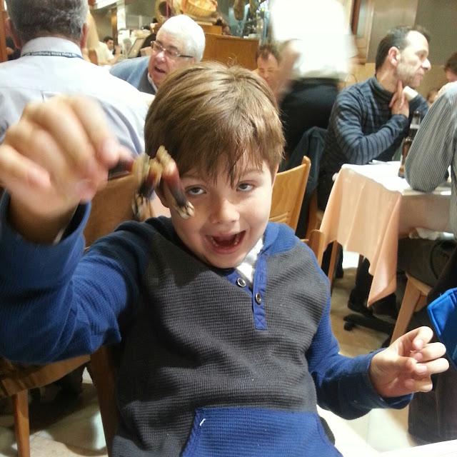 Jacob eats Barnacles at O Ramiro Lisbon Portugal