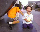 Eidan and Kai on the Awakening statue at Villanova