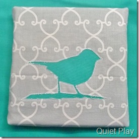 Reverse applique bird on a branch canvas