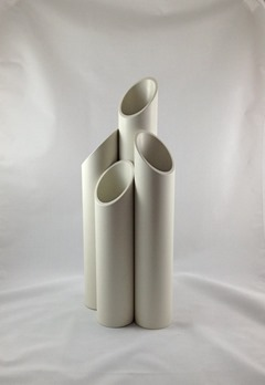 Tubular white plastic mod vase with four openings