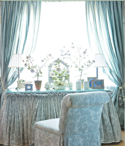 Roehm has created a sanctuary within this soft, blue bedroom.