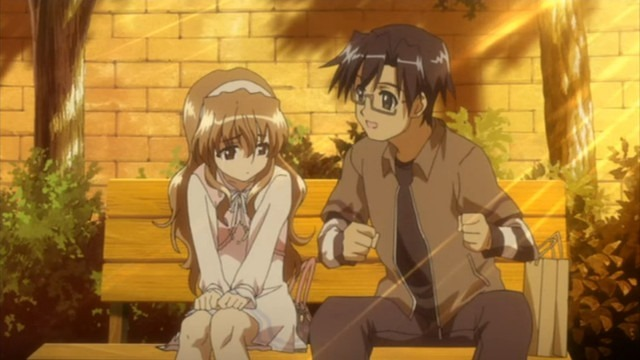 Haruka sits with Yuuta on a park bench in the warm late afternoon light as he tries to cheer her up with a pep talk