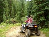 Kai on an ATV with James