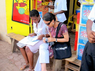 Accra, Ghana: Priyanka Gupta working with Comfort from Y-SEF, a microfinance organization based in Accra, Ghana as part of the Ghana course practicum. Photo credit: Courtney Babcock