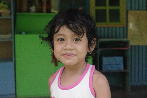 Adorable little Maya at our guesthouse.