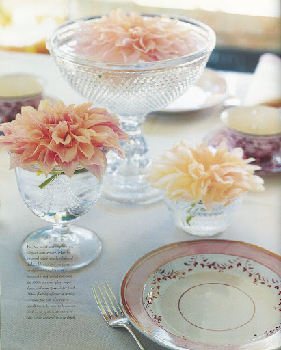 Dahlia blossoms in a Valentine's color scheme make for a simple and pretty centerpiece. Stagger them with bowls of varying heights.