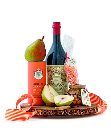 This is the perfect after-dinner kit complete with an exceptional red vermouth, Carpano Antica Formula vermouth, a favorite of our food editor Christine Albano, followed by fruit, cookies, candied peels, a paring knife, and a wooden tray that the host can use long after the last bit of fruit is gone.