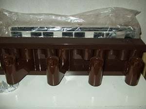 Brown Velca MiniVip coat rack with packaging