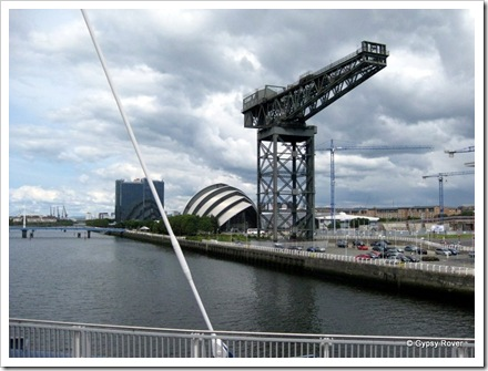 "Ship builders crane in front of the ""Armadillo"" The Scottish Exhibition and theatre complex."