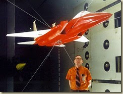 Langley researcher Moses Farmer with F-15 model in preparation1