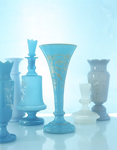 Enamel and gilt bouquets decorate a brilliant blue vase and turquoise decanter both with characteristically Bristol crenellated tops, and a shiny, trumpet-shape vase. (Martha Stewart Living)