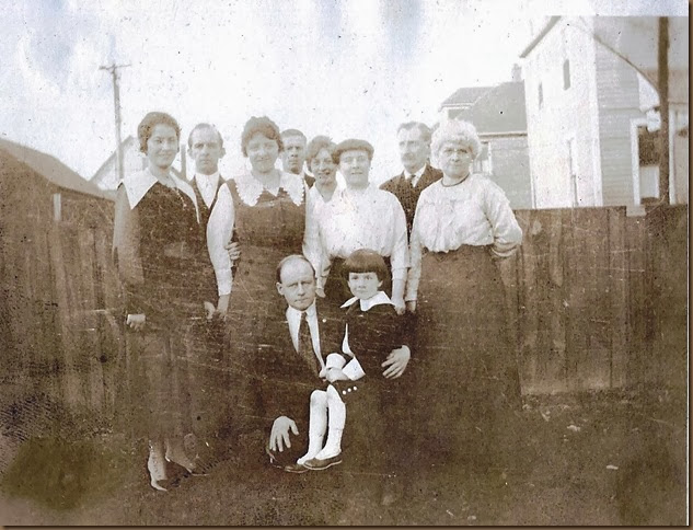 Dad sitting on Uncle Fords lap with his Grandma & parents & aunts & uncles all around_Christmas 1918