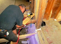 Terry installing a nailer for hallway wall.