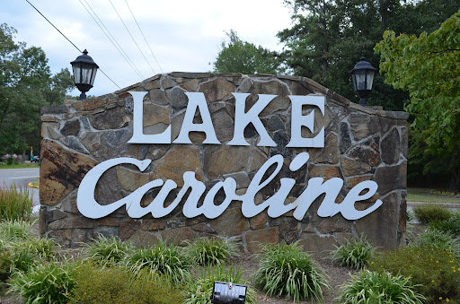 The entrance to Lake Caroline on Jefferson Davis Highway in Caroline County. Lake Caroline is a gated community containing more than 1,000 single family homes on over 1,400 acres. Amenities include a clubhouse, swimming pool, tennis and basketball courts, 2 beaches, 9 recreation areas, several pavilions, and a lake covering 277 acres over 2 miles with an average depth of 15 feet. For real estate information in Caroline County www.TheMoyersTeam.com