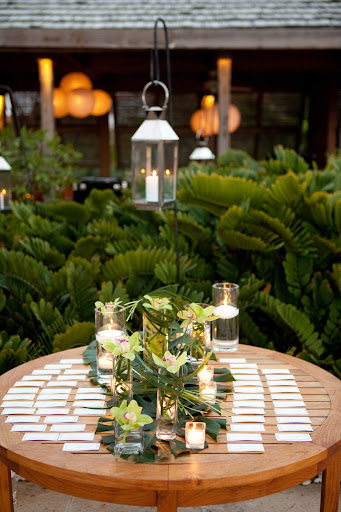 The escort-card table was decorated with orchids, candles, and tropical leaves.