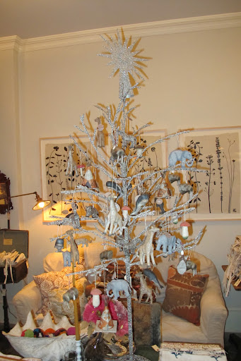 Though this tree looks extra frosty cool, it's donned with elephants and giraffes from warmer climates.