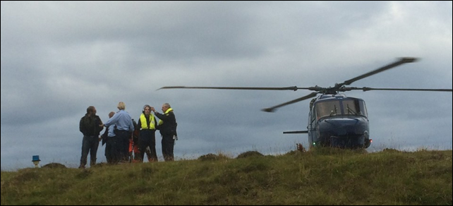 A police helicopter from Torshaven and officers arresting Sea Shepherd volunteers during the whale poaching event known as the Grind, 30 August 2014. Photo: Sea Shepherd Conservation Society