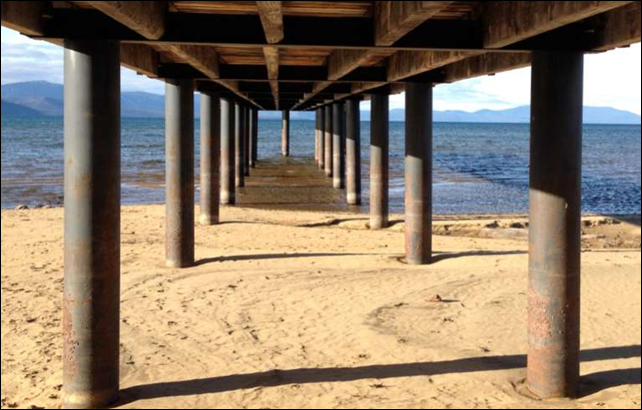 More sand than water is visible under the Tahoe Keys Pier, on Lake Tahoe, California, 8 January 2014. Photo: Kathryn Reed