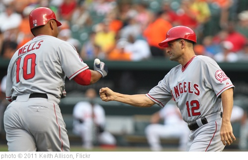 'Los Angeles Angels left fielder Vernon Wells (10) and third base coach Dino Ebel (12)' photo (c) 2011, Keith Allison - license: http://creativecommons.org/licenses/by-sa/2.0/