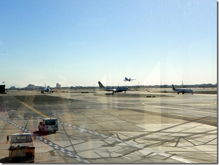 Busy airport, busy picture with shadows and reflections.