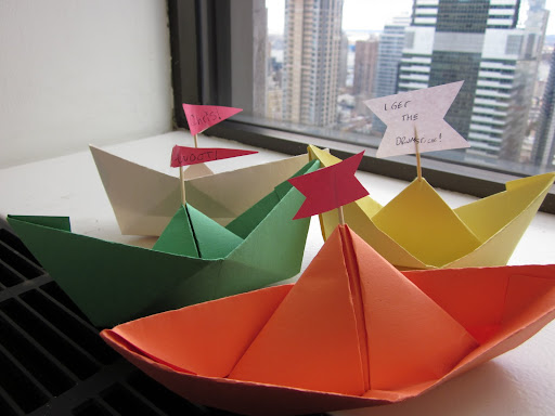 In honor of the mighty Mayflower, we crafted paper boat placecards for the Thanksgiving table.