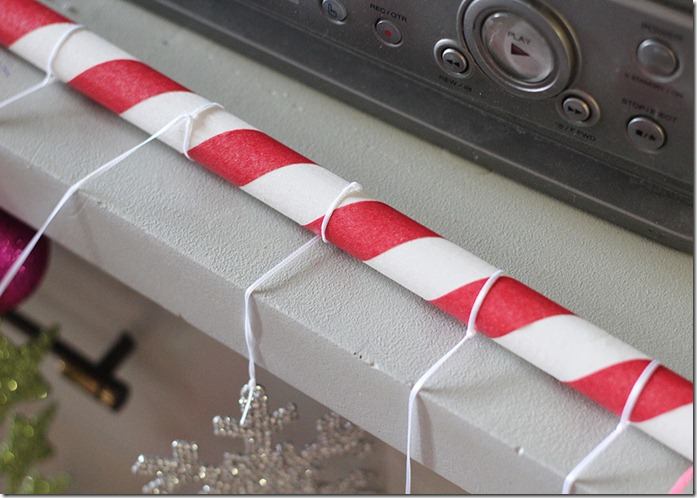 Tie Ribbon and ornaments to candy cane dowel