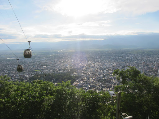Cable cars ascending a hill overlooking Salta.