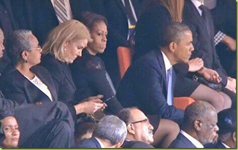 Obama-flirts-with-Denmark-PMs-seat switch