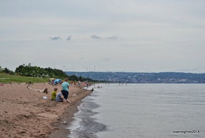Even with overcast skies, there are people at the beach