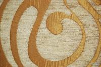 Tkanina obiciowa w stylu lat 60-tych, 70-tych. Złota.