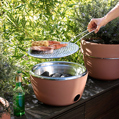 What a stealthy little grill. This compact grill doubles as a planter, but you can whip off the top to use the hidden barbeque. (uncommongoods.com)