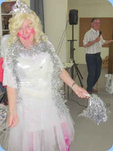 Fiona, the fairy, bringing Christmas cheer to the Prescott Club members whilst Len Hancy croons in the background