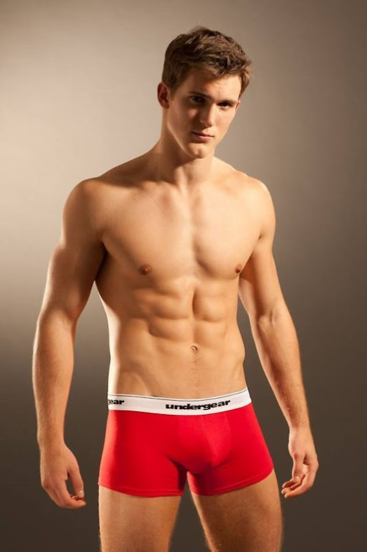 boyish guy in red undergear trunks