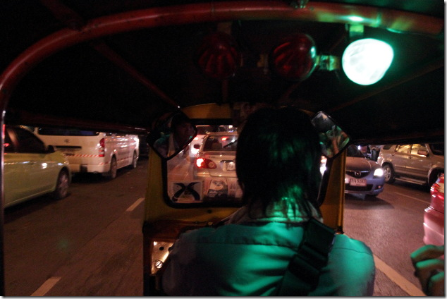 Bangkok city at night from a tuk tuk